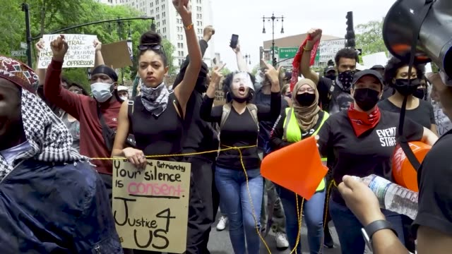 demonstrators rallied at foley square and marched throughout downtown manhattan in solidarity with the death of george floyd in minneapolis... - chanting stock videos & royalty-free footage