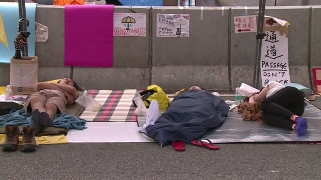 demonstrators remain camped out in the admiralty district ahead of proposed talks between the government and protest leaders - occupy central stock videos & royalty-free footage