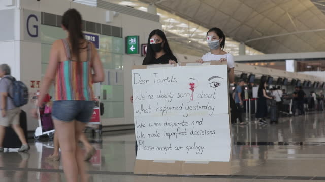 demonstrators sit on the arrival hall at the hong kong international airport in hong kong, china, on wednesday, aug 14, 2019. - hong kong international airport stock videos & royalty-free footage