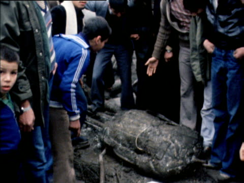 demonstrators spit and stamp on shah mohammed reza pahlavi of iran fallen statue tehran 17 jan 79 - イラン点の映像素材/bロール