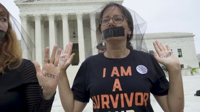 demonstrators stand before the united states supreme court in washington dc in protest of the confirmation of associate justice brett kavanaugh on... - brett kavanaugh stock videos and b-roll footage