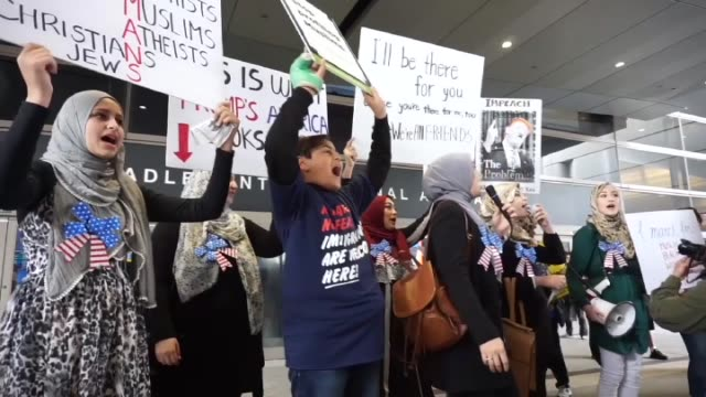Demonstrators support a ruling by a federal judge in Seattle that grants a nationwide temporary restraining order against the presidential order to...