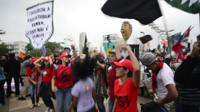 demonstrators take part in a national strike against a labour and social welfare reform bill that the government of president michel temer intends to... - participant stock videos and b-roll footage