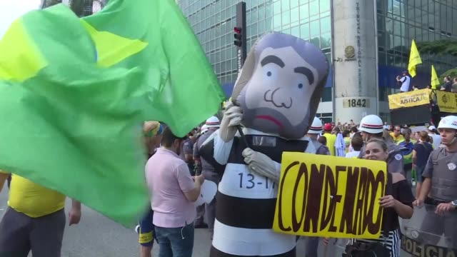 Demonstrators take to the streets to demand that Brazil's ex president Lula to be jailed a day before a Brazilian appeals court is set to rule on...