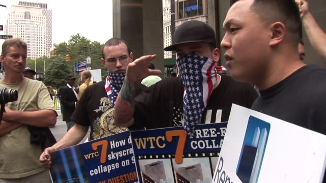 demonstrators talk directly to public to explain why they think 911 was an inside job / heated argument between two visitors new york city... - conspiracy stock videos & royalty-free footage