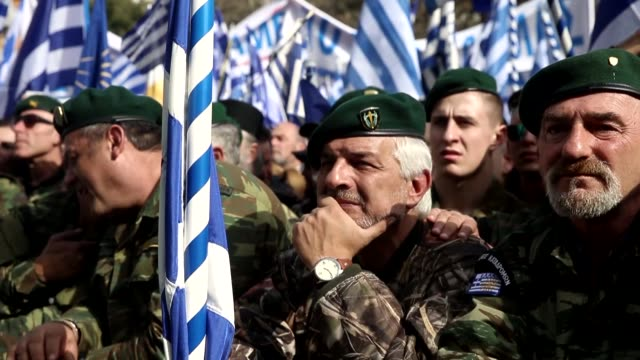 demonstrators wave greek national flags during a demonstration february 4 at the syntagma square in athens greece protesters gathered in the greek... - griechische flagge stock-videos und b-roll-filmmaterial