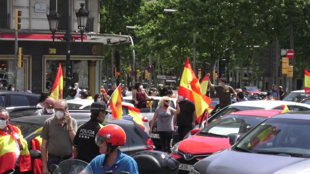 demonstrators wave spanish flags from their vehicles during the 'caravan for spain and its freedom' protest by the far-right political party vox... - spanish culture video stock e b–roll