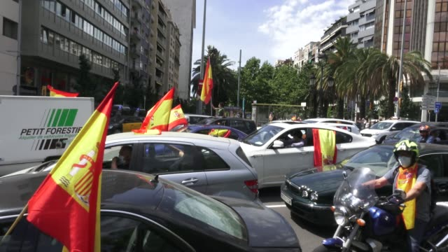 demonstrators wave spanish flags from their vehicles during the 'caravan for spain and its freedom' protest by the farright political party vox... - political party stock videos & royalty-free footage