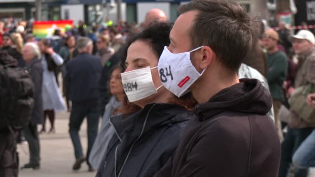 demonstrators wearing a face mask with the inscription 1984 referring to the novel 1984 by george orwell which describes a totalitarian surveillance... - 1984 stock videos & royalty-free footage