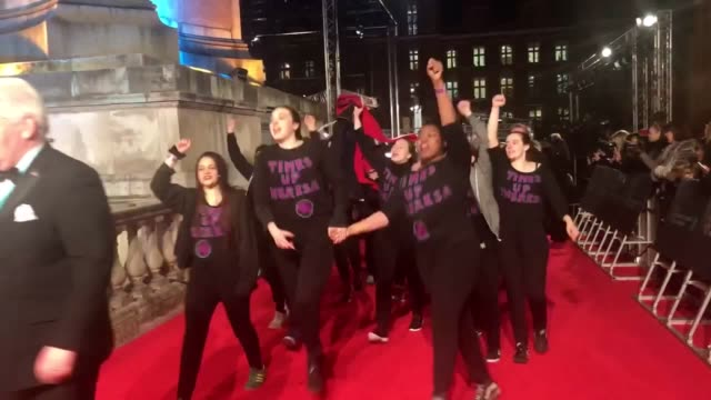 demonstrators wearing customised 'time's up theresa' sweatshirts storm the red carpet before the 2018 bafta awards - time's up social movement stock videos and b-roll footage
