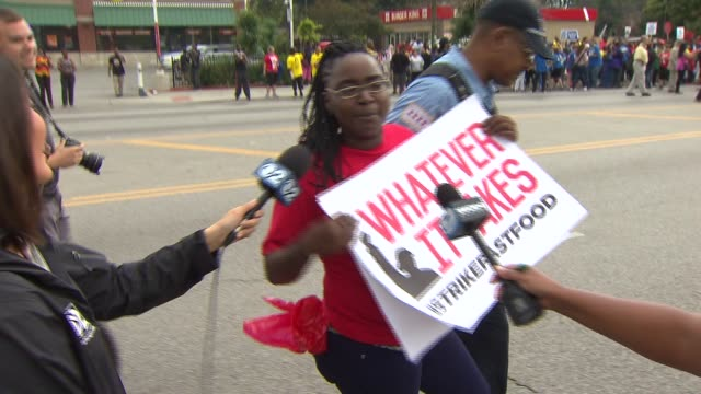 19 demonstrators where detained by Chicago police after they blocked traffic in front of a McDonalds in the Chatham neighborhood of Chicago The...