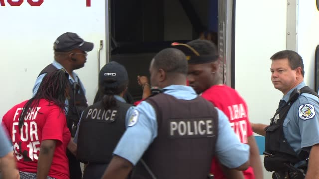 19 demonstrators where detained by chicago police after they blocked traffic in front of a mcdonalds in the chatham neighborhood of chicago the... - detainee stock videos & royalty-free footage