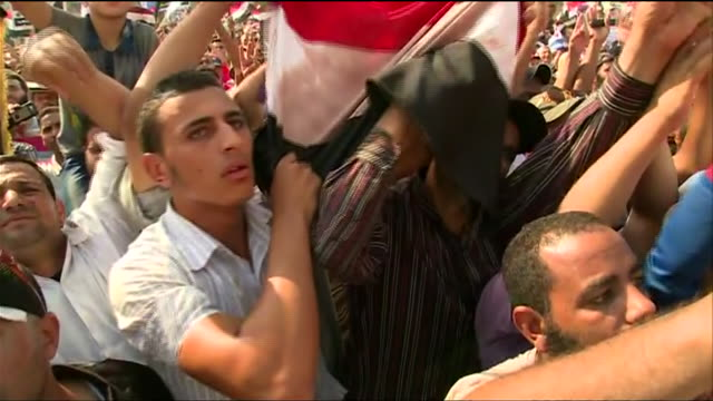 demonstrators who support deposed president mohamed morsi gather at a rally to oppose the 2013 egyptian military coup - (war or terrorism or election or government or illness or news event or speech or politics or politician or conflict or military or extreme weather or business or economy) and not usa stock videos & royalty-free footage