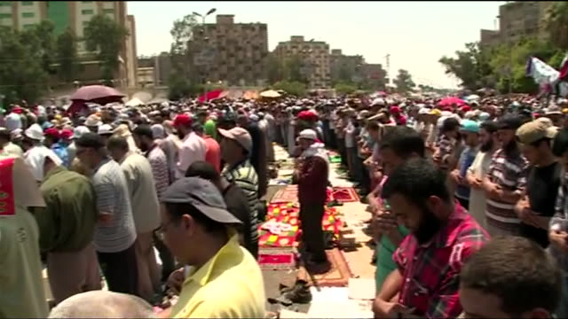 demonstrators who support president mohamed morsi pray at a protest against the 2013 egyptian military coup - (war or terrorism or election or government or illness or news event or speech or politics or politician or conflict or military or extreme weather or business or economy) and not usa stock videos & royalty-free footage