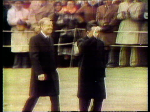 deng xiaoping and president jimmy carter walk along and wave to crowds during xiaoping's visit to washington dc 30 jan 79 - jimmy carter präsident stock-videos und b-roll-filmmaterial