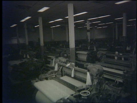 denim jeans factory plans to export to us and japan / models modeling denim clothing / denim textile factory machinery workers producing denim /... - 1971 stock-videos und b-roll-filmmaterial