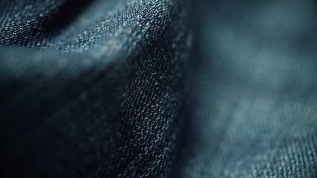 vídeos de stock e filmes b-roll de denim material texture close-up. dolly shot - jeans