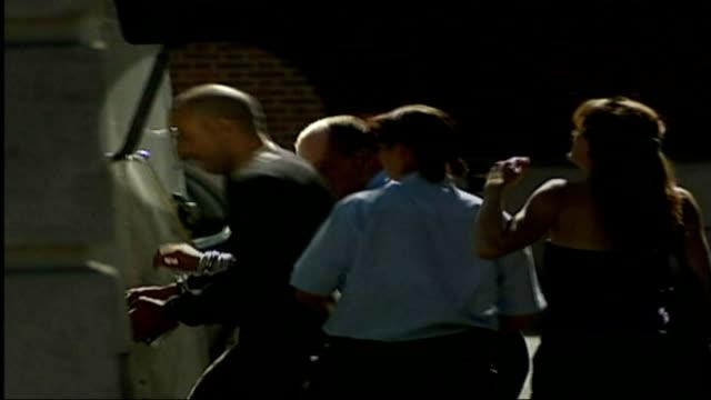 vídeos de stock, filmes e b-roll de report critical of mental health hospital lib surrey kingston magistrates court barrett in handcuffs next police security van dissolve to - algema