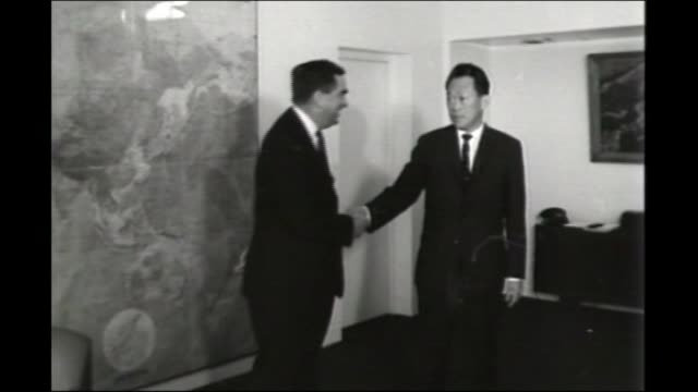 denis healey dies aged 98 fs220466009 / tx b/w healey shaking hands with lee kwan yew - denis healey stock videos & royalty-free footage