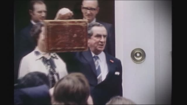 denis healey dies aged 98 lib london downing street no11 ext denis healey mp holding up red budget box lib london heathrow airport ext slow motion... - denis healey stock videos & royalty-free footage