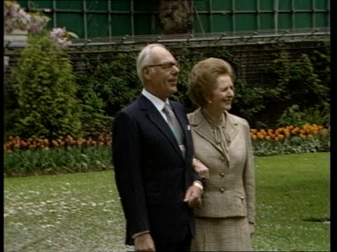b england london downing street denis thatcher and margaret thatcher arminarm in garden posing for photocall ms side cameramen in garden lms denis... - fawn stock videos & royalty-free footage