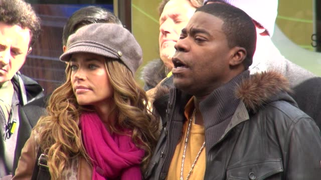 Denise Richards Tracy Morgan and Tina Fey on the set of 30 Rock in New York