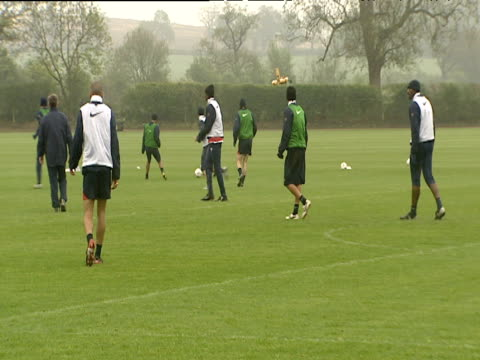 Dennis Bergkamp running with ball before passing Robert Pires collects runs in opposite direction during Arsenal FC training session London Colney 18...
