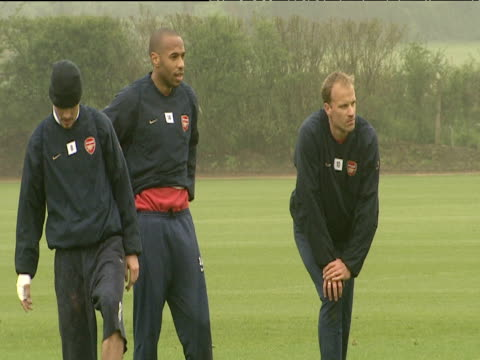 Dennis Bergkamp Thierry Henry Freddie Ljungberg Robert Pires and Sol Campbell look on as colleagues practice shooting Arsenal FC training session...