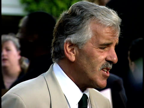 Dennis Farina talks to a reporter on the red carpet at the Out of Sight Premiere