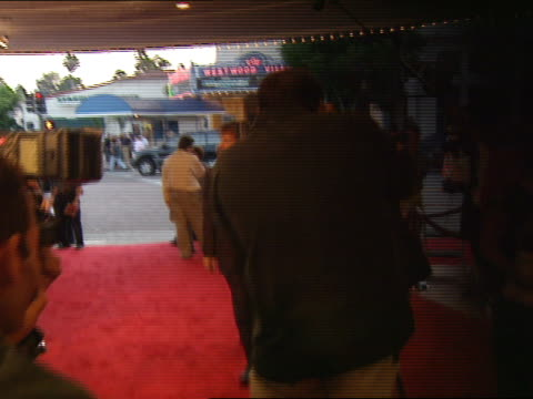 Dennis Quaid and Shanna Moakler moving along red carpet posing for paparazzi on red carpet before entering Bruin Theater