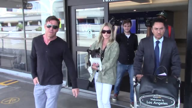 Dennis Quaid Kimberly Quaid arriving at LAX Airport in Los Angeles in Celebrity Sightings in Los Angeles
