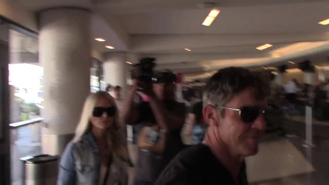 Dennis Quaid Kimberly Quaid departing at LAX Airport in Los Angeles Celebrity Sightings on Aug 27 2015 in Los Angeles California