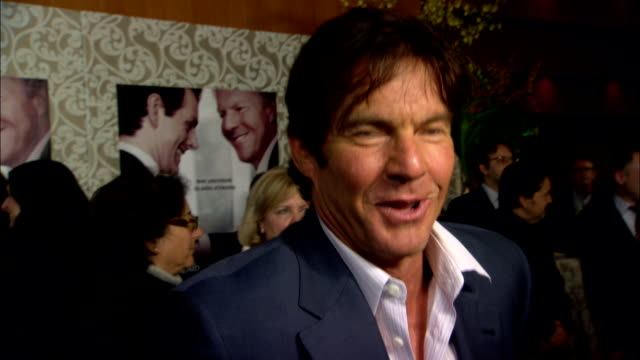 Dennis Quaid talking to reporter on the red carpet at the Directors Guild of America