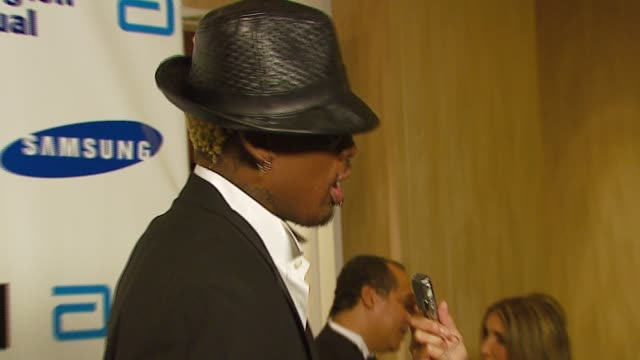 dennis rodman at the celebrities honor magic johnson for 'magic evolution' at the beverly hilton in beverly hills california on september 29 2006 - magic johnson stock videos and b-roll footage