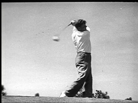 denny shute takes a swing caddy standing with golf bag myron nelson swings jimmy thompson drives golf ball vic ghezzi swings club pan across fairway... - golf bag stock videos and b-roll footage
