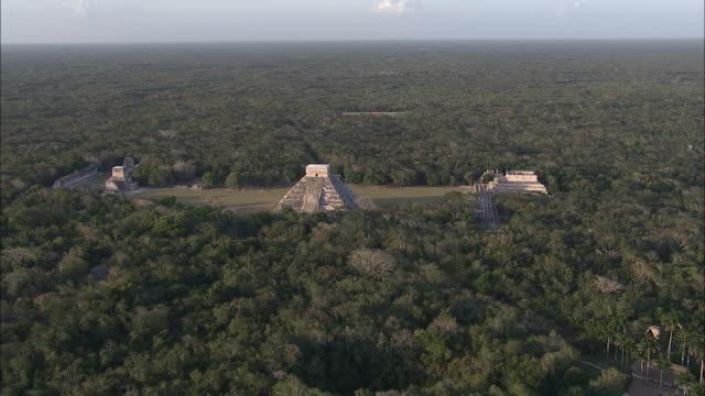 dense jungle surrounds the pyramids of chichen itza. - latin america stock videos & royalty-free footage