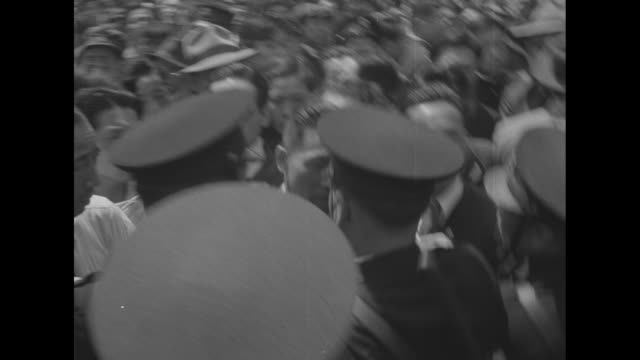 dense line of tokyo police attempt to hold back crowd, which is predominantly men, during celebration of constitution memorial day / vs police and... - pinaceae stock videos & royalty-free footage