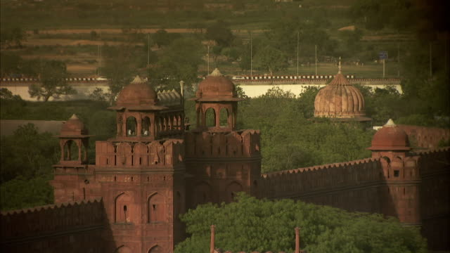 Dense trees surround the Red Fort in Delhi, India.