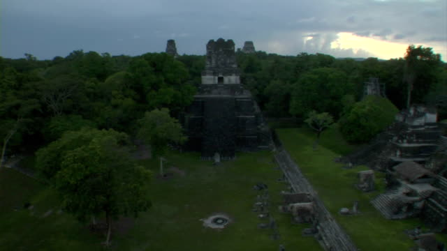 a dense tropical rainforest encompasses an ancient mayan city. - latin american civilizations stock videos and b-roll footage