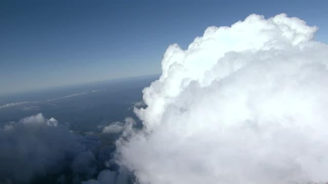 Dense white clouds billow up into the blue sky over Hokkaido, Japan.