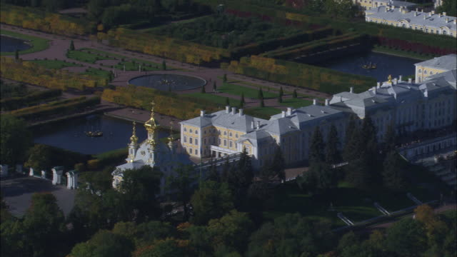 Dense woods surround Catherine Palace in Saint Petersburg.