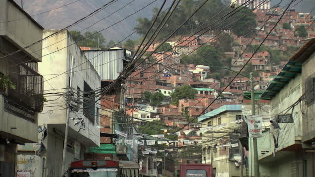 ws td densely clustered homes on terraced hillside in petare / caracas, miranda, venezuela - venezuela stock videos & royalty-free footage