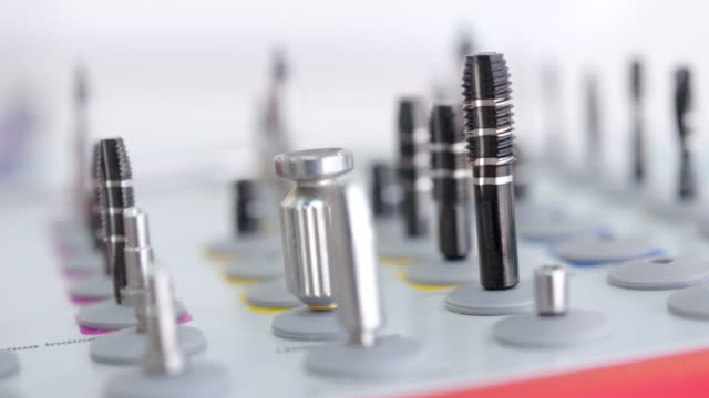 dental drill bits - dental implants stock videos and b-roll footage