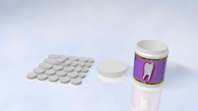 vídeos de stock e filmes b-roll de dentista comprimido - vitamina a