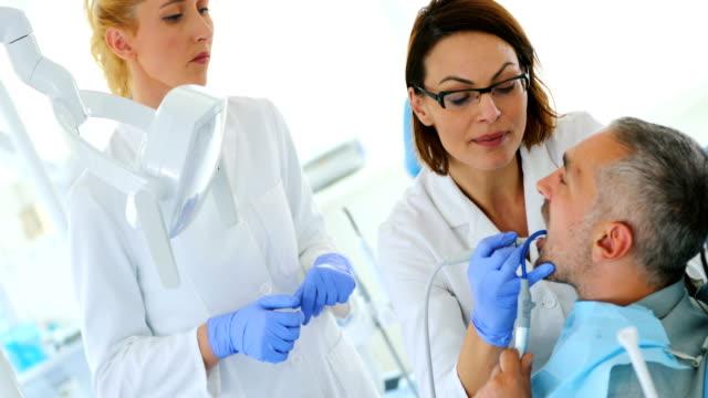 dental procedure. - plaque bacteria stock videos & royalty-free footage