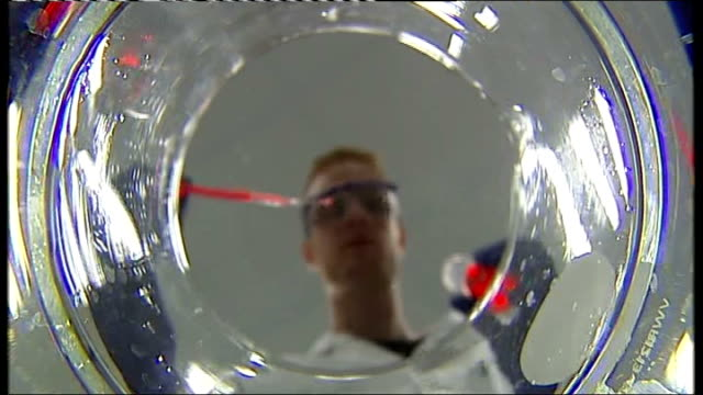 dental researchers discover new treatment for filling cavities england yorkshire leeds leeds university int dentist lowering drill towards camera sot... - liquid solution stock videos and b-roll footage
