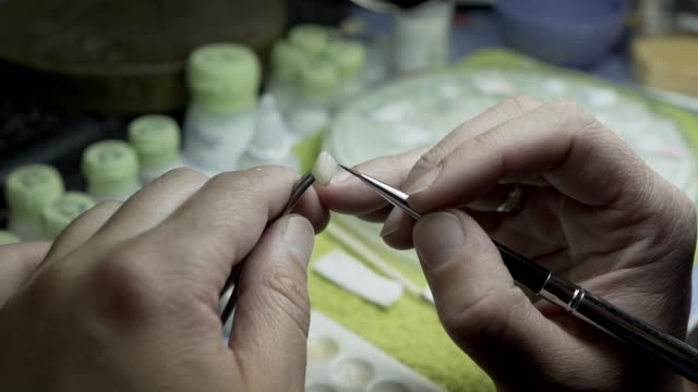 dental technician making new teeth from the scratch for a patient. dentist fixing the teeth at dental office in low light with using dental dental equipments. the dentist preparing the teeth. - dental hygiene stock videos & royalty-free footage
