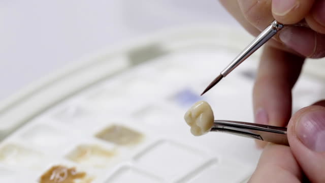 Dental technician working on a tooth crown