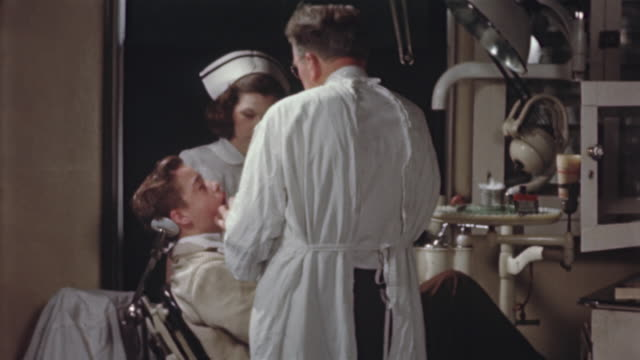 1955 montage ms dentist and assistant working on male patient/ usa - dentist's office stock videos and b-roll footage