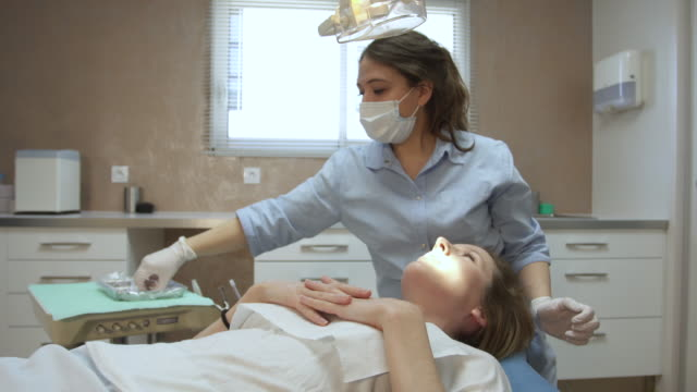 dentist at work in the office - surgical mask stock videos & royalty-free footage
